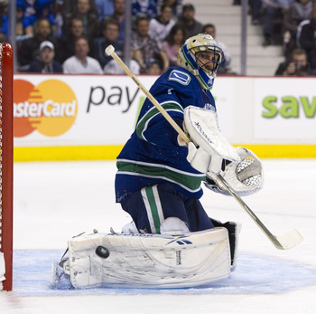 VANCOUVER, CANADA - APRIL 13: Goalie Roberto Luongo #1of the Vancouver Canucks makes a save during the second period in Game One of the Western Conference Quarterfinals during the 2011 NHL Stanley Cup Playoffs on April 13, 2011 at Rogers Arena in Vancouve