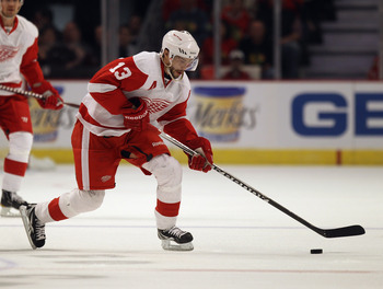 CHICAGO, IL - APRIL 10: Pavel Datsyuk #13 of the Detroit Red Wings skates to the puck against the Chicago Blackhawks at the United Center on April 10, 2011 in Chicago, Illinois. The Red Wings defeated the Blackhawks 4-3. (Photo by Jonathan Daniel/Getty Im