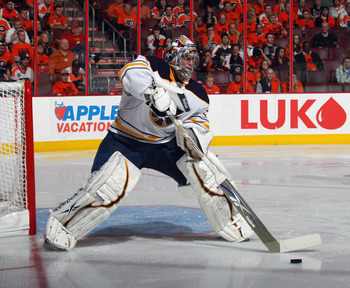 PHILADELPHIA, PA - APRIL 14:  Ryan Miller #30 of the Buffalo Sabres plays the puck against the Philadelphia Flyers in Game One of the Eastern Conference Quarterfinals during the 2011 NHL Stanley Cup Playoffs at Wells Fargo Center on April 14, 2011 in Phil