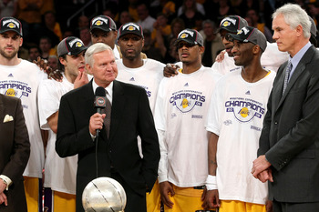 LOS ANGELES, CA - MAY 29:  Los Angeles Lakers legend Jerry West presents the Western Conference Championship trophy to General Manager Mitch Kupchak of the Los Angeles Lakers after they defeated the San Antonio Spurs in Game Five of the Western Conference