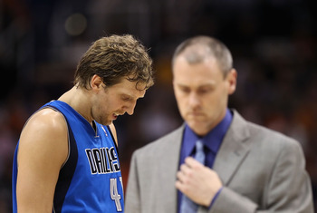 PHOENIX, AZ - MARCH 27:  Dirk Nowitzki #41 of the Dallas Mavericks walks by head coach Rick Carlisle during the NBA game against the Phoenix Suns at US Airways Center on March 27, 2011 in Phoenix, Arizona.  The Mavericks defeated the Suns 91-83.  NOTE TO