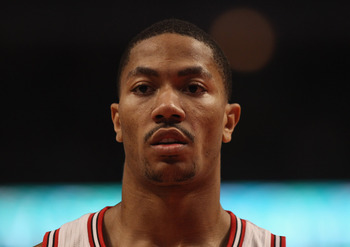 CHICAGO, IL - APRIL 13: Derrick Rose #1 of the Chicago Bulls awaits the start of play after a time-out against the New Jersey Nets at United Center on April 13, 2011 in Chicago, Illinois. The Bulls defeated the Nets 97-92. NOTE TO USER: User expressly ack