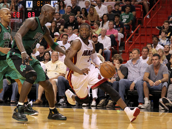 MIAMI, FL - APRIL 10:  Dwyane Wade #3 of the Miami Heat drives on Kevin Garnett #5 of the Boston Celtics during a game  at American Airlines Arena on April 10, 2011 in Miami, Florida. NOTE TO USER: User expressly acknowledges and agrees that, by downloadi