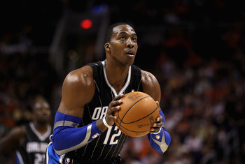 PHOENIX, AZ - MARCH 13:  Dwight Howard #12 of the Orlando Magic shoots a free throw shot during the NBA game against the Phoenix Suns at US Airways Center on March 13, 2011 in Phoenix, Arizona. The Magic defeated the Suns 111-88. NOTE TO USER: User expres