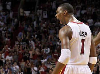 MIAMI, FL - APRIL 10: Chris Bosh #1 of the Miami Heat reacts after being fouled during a game against the Boston Celtics at American Airlines Arena on April 10, 2011 in Miami, Florida. NOTE TO USER: User expressly acknowledges and agrees that, by download