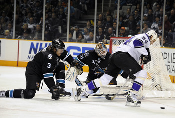 SAN JOSE, CA - APRIL 14: Antti Niemi #31 of the San Jose Sharks gets help from teammate Douglas Murray #3 defending his goal against Ryan Smyth #94 of the Los Angeles Kings in Game One of the Western Conference Quarterfinals  during the 2011 NHL Stanley C