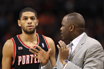 PHOENIX, AZ - JANUARY 14:  Head coach Nate McMillan of the Portland Trail Blazers talks with Nicolas Batum #88 during the NBA game against the Phoenix Suns at US Airways Center on January 14, 2011 in Phoenix, Arizona.  The Suns defeated the 115-111.  NOTE