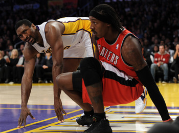 LOS ANGELES, CA - MARCH 20:  Ron Artest #15 of the Los Angeles Lakers reacts for a foul call in front of Gerlad Wallace #3 of the Portland Trail Blazers at the Staples Center on March 20, 2011 in Los Angeles, California.  NOTE TO USER: User expressly ackn