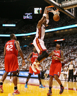 MIAMI, FL - APRIL 16:  Forward Chris Bosh #1 of the  Miami Heat dunks against the Philadelphia 76ers at the American Airlines Arena in game one of the Eastern Conference Quarterfinals in the 2011 NBA Playoffs on April 16, 2011 in Miami, Florida. NOTE TO U