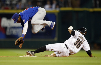 HOUSTON - APRIL 12:  Angel Sanchez #36 is forced out at second base as shortstop Starlin Castro #13 of the Chicago Cubs avoids the slide at Minute Maid Park on April 12, 2011 in Houston, Texas.  (Photo by Bob Levey/Getty Images)