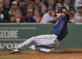 BOSTON, MA - APRIL 11:  Sam Fuld #5 of the Tampa Bay Rays scores on a wild pitch against the Boston Red Sox at Fenway Park April 11, 2011 in Boston, Massachusetts. (Photo by Jim Rogash/Getty Images)