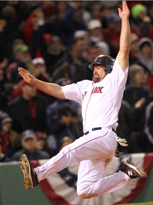 BOSTON, MA - APRIL 10:  Kevin Youkilis #20 of the Boston Red Sox scores a run on a double hit by  David Ortiz against the New York Yankees in the seventh inning at Fenway Park April 10, 2011 in Boston, Massachusetts. (Photo by Jim Rogash/Getty Images)
