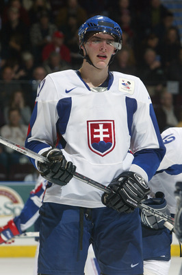 KELOWNA, CANADA - DECEMBER 27:  Juraj Mikus #12 of Team Slovakia skates against Team Latvia during their World Junior Hockey Championship game at Prospera Place on December 27, 2005 in Kelowna, British Columbia, Canada.  Slovakia defeated Latvia 7-4. (Pho