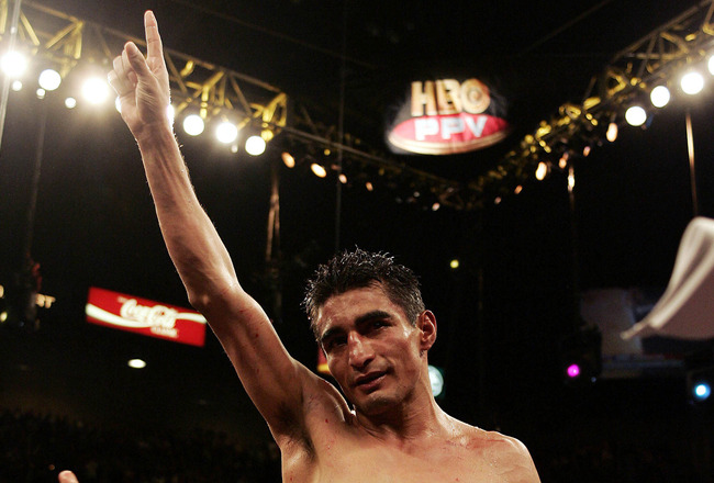 LAS VEGAS - MARCH 19:  Eric Morales of Mexico celebrates his 15-13 unanimous decision victory over Manny Pacquiao of Philippines during the World Super Featherweight Championship at the MGM Grand Hotel on March 19, 2005 in Las Vegas, Nevada.  (Photo by Do