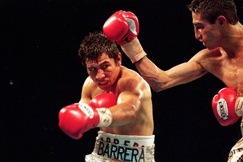 19 Feb 2000: Marco Barrera makes a left swing during the WBC/WBO Super Bantamwight Championship against Erik Morales in Las Vegas, Nevada. Morales won by a decision in the 12th round. Mandatory Credit: Jed Jacobsohn  /Allsport