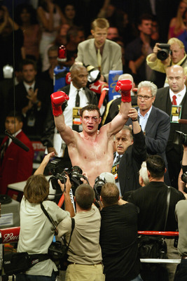 LOS ANGELES - JUNE 21:  Vitali Klitschko raises his hands in the air to the crowd after the WBC and IBO World Heavyweight Championship bout against Lennox Lewis at the Staples Center on June 21, 2003 in Los Angeles, California.  Lennox Lewis (41-2-1) defe