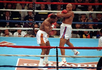 19 Apr 1991:  Evander Holyfield lands a left punch during a fight against George Foreman in Atlantic City, New Jersey. Mandatory Credit: Rick Stewart  /Allsport