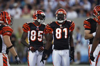 CANTON, OH - AUGUST 8: Terrell Owens #81 and Chad Ochocinco #85 of the Cincinnati Bengals look on against the Dallas Cowboys during the 2010 Pro Football Hall of Fame Game at the Pro Football Hall of Fame Field at Fawcett Stadium on August 8, 2010 in Cant