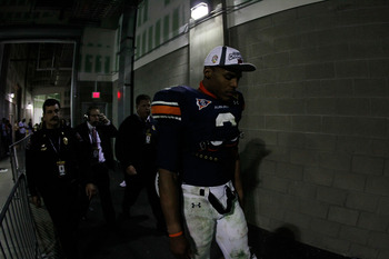 GLENDALE, AZ - JANUARY 10:  Quarterback Cameron Newton #2 of the Auburn Tigers walks through the tunnel towards the locker room after the Tigers 22-19 victory against the Oregon Ducks in the Tostitos BCS National Championship Game at University of Phoenix