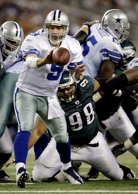 ARLINGTON, TX - JANUARY 9:  Tony Romo #9 of the Dallas Cowboys pitches the ball in the fourth quarter against the Philadelphia Eagles during the 2010 NFC wild-card playoff game at Cowboys Stadium on January 9, 2010 in Arlington, Texas. (Photo by Jamie Squ