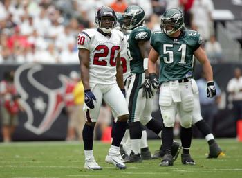 HOUSTON - SEPTEMBER 10:  Dexter McCleon #20 of the Houston Texans walks on the field with Matt McCoy #51 of the Philadelphia Eagles on September 10, 2006 at Reliant Stadium in Houston, Texas. (Photo by Ronald Martinez/Getty Images)