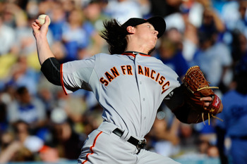 LOS ANGELES, CA - MARCH 31:  Tim Lincecum #55 of the San Francisco Giants throws a pitch against the Los Angeles Dodgers on Opening Day at Dodger Stadium on March 31, 2011 in Los Angeles, California.  (Photo by Kevork Djansezian/Getty Images)