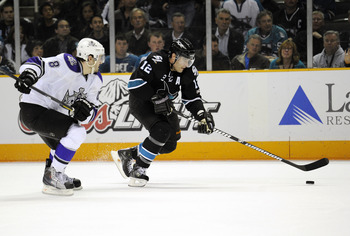 SAN JOSE, CA - APRIL 14: Patrick Marleau #12 of the San Jose Sharks, in overtime breaks away from Drew Doughty #8 of the Los Angeles Kings in Game One of the Western Conference Quarterfinals  during the 2011 NHL Stanley Cup Playoffs at the HP Pavilion on