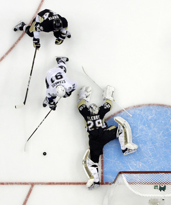 PITTSBURGH, PA - APRIL 15:  Marc-Andre Fleury #29 of the Pittsburgh Penguins makes a save on Steven Stamkos #91 of the Tampa Bay Lightning in Game Two of the Eastern Conference Quarterfinals during the 2011 NHL Stanley Cup Playoffs at Consol Energy Center