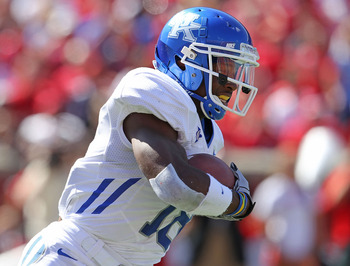 LOUISVILLE, KY - SEPTEMBER 04:  Randall Cobb #18 of the Kentucky Wildcats runs with the ball during the game against the Louisville Cardinals at Papa John's Cardinal Stadium on September 4, 2010 in Louisville, Kentucky.  (Photo by Andy Lyons/Getty Images)