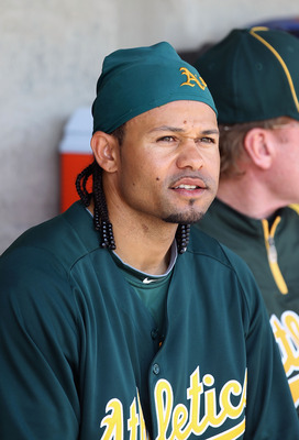 PHOENIX, AZ - MARCH 03:  Coco Crisp #4 of the Oakland Athletics sits in the dugout before the spring training game against the Milwaukee Brewers at Maryvale Baseball Park on March 3, 2011 in Phoenix, Arizona.  (Photo by Christian Petersen/Getty Images)