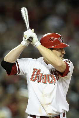 PHOENIX, AZ - APRIL 08:  Xavier Nady #22 of the Arizona Diamondbacks bats against the Cincinnati Reds during the Major League Baseball home opening game at Chase Field on April 8, 2011 in Phoenix, Arizona. The Diamondbacks defeated the Reds 13-2.  (Photo