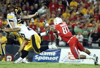 TUCSON, AZ - SEPTEMBER 18:  Punter Ryan Donahue #5 of the Iowa Hawkeyes has a first-quarter punt blocked by the diving David Roberts #81 of the Arizona Wildcats during the college football game at Arizona Stadium on September 18, 2010 in Tucson, Arizona.