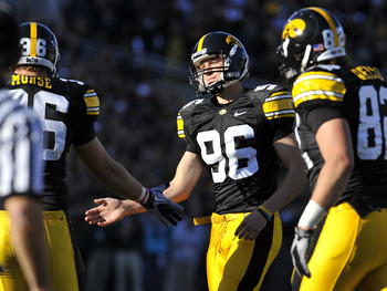 IOWA CITY, IA - OCTOBER 30- Kicker Mike Meyer #96 of the University of Iowa Hawkeyes celebrates with teammate Brett Morse #36 after kicking an extra point during play against the Michigan State Spartans at Kinnick Stadium on October 30, 2010 in Iowa City,