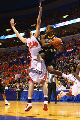 ST. LOUIS, MO - DECEMBER 22: Kim English #24 of the Missouri Tigers looks to shoot the ball against the Illinois Fighting Illini during the Busch Braggin' Rights game at the Scottrade Center on December 22, 2010 in St. Louis, Missouri.  The Tigers beat th