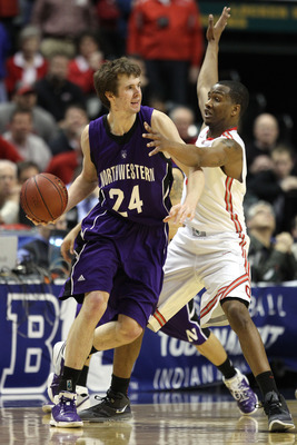 INDIANAPOLIS, IN - MARCH 11:  John Shurna #24 of the Northwestern Wildcats looks to pass against the William Buford #44 of the Ohio State Buckeyes during the quarterfinals of the 2011 Big Ten Men's Basketball Tournament at Conseco Fieldhouse on March 11,
