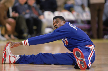 LOS ANGELES - 1990:  Dennis Hopson #2 of the New Jersey Nets stretches before the NBA game against the Los Angeles Lakers at the Great Western Forum in Los Angeles, California in 1990. NOTE TO USER: User expressly acknowledges and agrees that, by download
