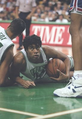 1 Dec 1995:  Center Pervis Ellison of the Boston Celtics lays on the court during a game against the New Jersey Nets at the Fleet Center in Boston, Massachusetts.  The Nets won the game 131-123. Mandatory Credit: Allsport  /Allsport