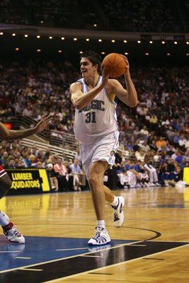 ORLANDO, FL - NOVEMBER 1:  Darko Milicic #31 of the Orlando Magic holds the ball against the Chicago Bulls on November 1, 2006 at TD Waterhouse Centre in Orlando, Florida. The Magic won 109-94. NOTE TO USER: User expressly acknowledges and agrees that, by