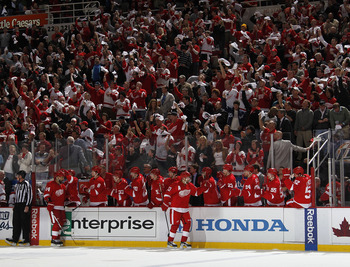 DETROIT, MI - APRIL 16: Pavel Datsyuk #13 of the Detroit Red Wings celebrates a first-period goal with the bench while playing the Phoenix Coyotes in Game Two of the Western Conference Quarterfinals during the 2011 Stanley Cup Playoffs at Joe Louis Arena