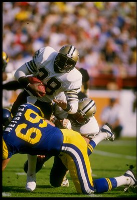 1988:  Halfback George Rogers of the New Orleans Saints runs with the ball during a game against the Los Angeles Rams at Anaheim Stadium in Anaheim, California. Mandatory Credit: Rick Stewart  /Allsport