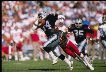 30 Oct 1988: Running back Bo Jackson of the Los Angeles Raiders moves the ball during a game against the Kansas City Chiefs at the Los Angeles Memorial Coliseum in Los Angeles, California. The Raiders won the game, 17-10.