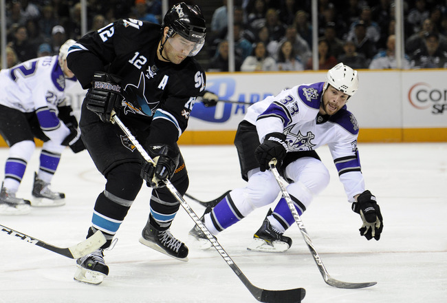SAN JOSE, CA - APRIL 16: Willie Mitchell #33 of the Los Angeles Kings tries to slow down Patrick Marleau #12 of the San Jose Sharks in Game Two of the Western Conference Quarterfinals during the 2011 NHL Stanley Cup Playoffs at the HP Pavilion on April 16