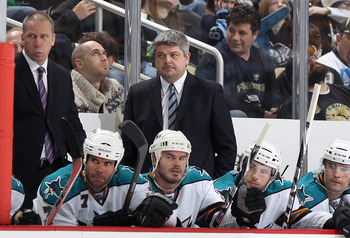 PITTSBURGH, PA - FEBRUARY 23:  Head coach Todd McLellan of the San Jose Sharks watches from the bench during the NHL game against the Pittsburgh Penguins at Consol Energy Center on February 23, 2011 in Pittsburgh, Pennsylvania.  The Sharks defeated the Pe