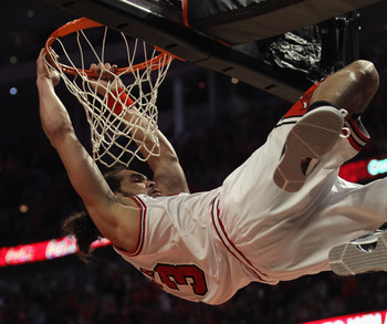 CHICAGO, IL - APRIL 16: Joakim Noah #13 of the Chicago Bulls hangs on the basket after dunking the ball against the Indiana Pacers in Game One of the Eastern Conference Quarterfinals in the 2011 NBA Playoffs at the United Center on April 16, 2011 in Chica