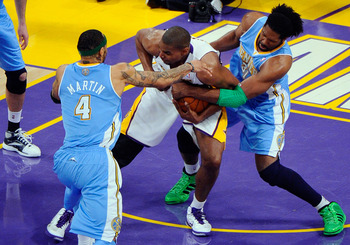 LOS ANGELES, CA - APRIL 03:  Kenyon Martin #4 and Nene #31 of the Denver Nuggets surround Andrew Bynum #17 of the Los Angeles Lakers during the game at Staples Center on April 3, 2011 in Los Angeles, California. NOTE TO USER: User expressly acknowledges a