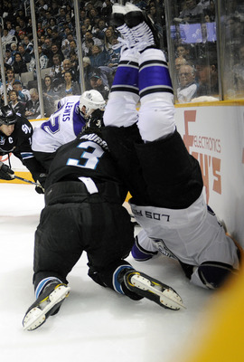 SAN JOSE, CA - APRIL 14: Dustin Brown #23 of the Los Angeles Kings flips over Douglas Murray #3 of the San Jose Sharks in Game One of the Western Conference Quarterfinals  during the 2011 NHL Stanley Cup Playoffs at the HP Pavilion on April 14, 2011 in Sa