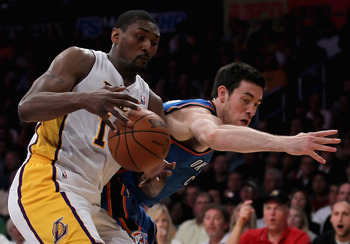 LOS ANGELES, CA - APRIL 10:  Nick Collison #4 of the Oklahoma City Thunder attempts to steal the ball from Ron Artest #15 of the Los Angeles Lakers in the first half at Staples Center on April 10, 2011 in Los Angeles, California. The Thunder defeated the