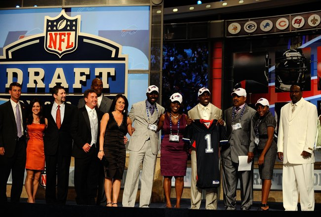 NEW YORK - APRIL 22:  C.J. Spiller from the Clemson Tigers holds up a Buffalo Bills jersey as he poses with friends and family after he was selected number 9 overall by the Bills during the first round of the 2010 NFL Draft at Radio City Music Hall on Apr