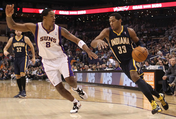 PHOENIX - DECEMBER 03:  Danny Granger #33 of the Indiana Pacers drives the ball against Channing Frye #8 of the Phoenix Suns during the NBA game at US Airways Center on December 3, 2010 in Phoenix, Arizona. NOTE TO USER: User expressly acknowledges and ag