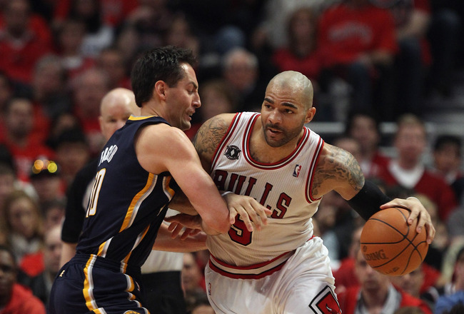 CHICAGO, IL - APRIL 16: Carlos Boozer #5 of the Chicago Bulls moves against Jeff Foster #10 of the Indiana Pacers in Game One of the Eastern Conference Quarterfinals in the 2011 NBA Playoffs at the United Center on April 16, 2011 in Chicago, Illinois. The